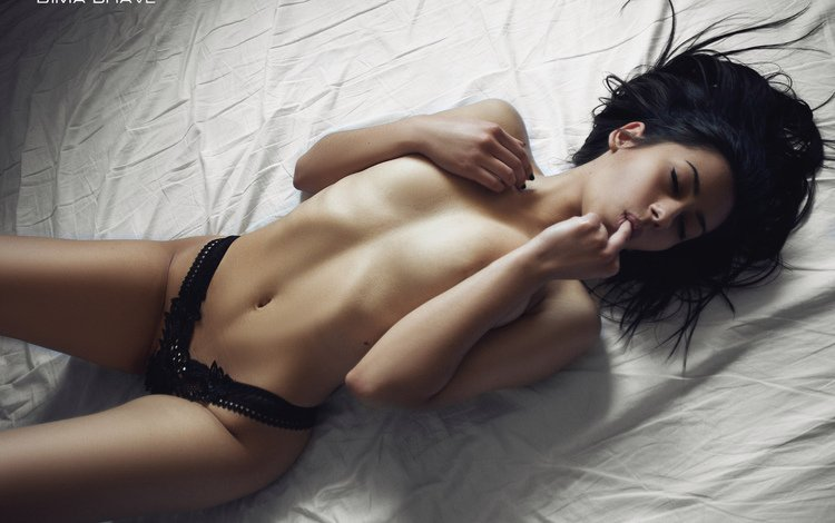 girl, back, nude, topless, belly, ribs, black lingerie, closed eyes, black panties, in bed, lying on the back, tanned, the finger in mouth