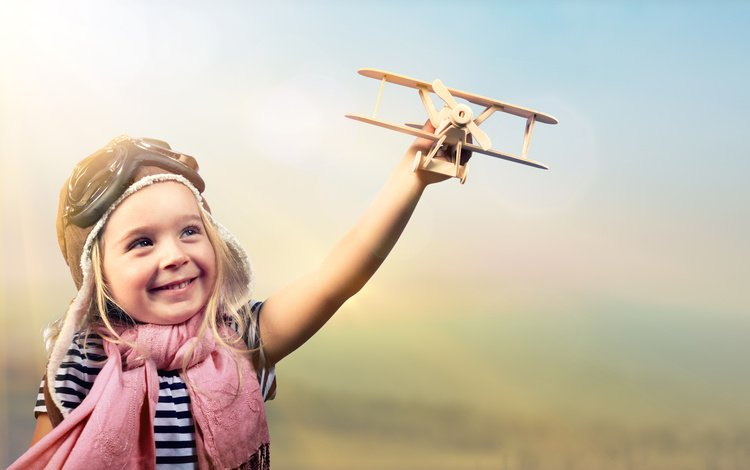 the plane, smile, helmet, girl, toy, child, t-shirt, scarf
