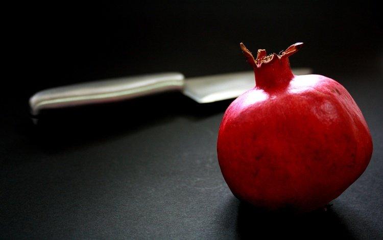 fruit, black background, knife, garnet