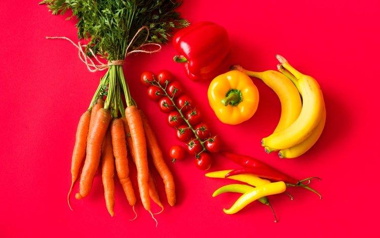 fruit, vegetables, red background, tomatoes, carrots, bananas, pepper