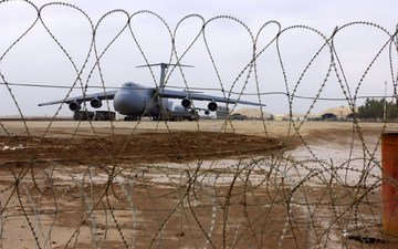 the plane, barbed wire, runway