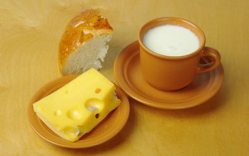 table, cheese, bread, milk, cup, saucers