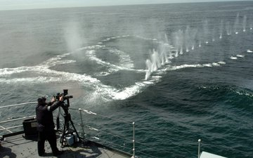 ship, machine gun, deck, shots, at, water