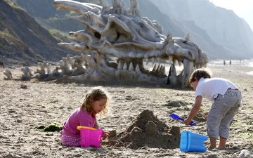 sand, children, dragon skull