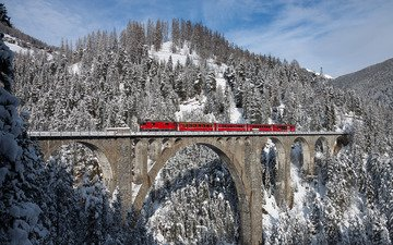 the sky, trees, mountains, snow, forest, winter, bridge, switzerland, train, viaduct, composition