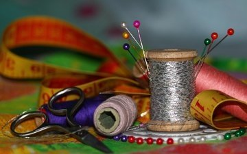 needles, scissors, thread, centimeter, coil, beads, sewing