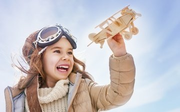 the plane, smile, glasses, children, girl, toys, laughter