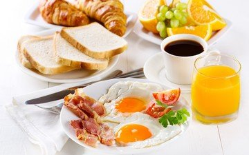 fruit, coffee, bread, breakfast, juice, scrambled eggs, bacon