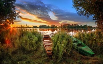 the sky, grass, lake, the sun, nature, shore, sunset, boats, boat, the reeds