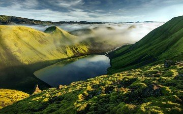 the sky, grass, clouds, water, lake, mountains, rocks, hills, nature, stones, greens, reflection, landscape, fog, iceland, reservoir, relief, hill, ridge