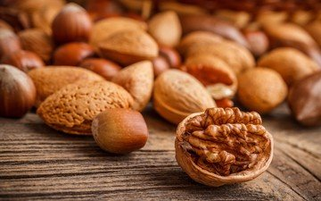 nuts, hazelnuts, almonds, walnut, wooden surface