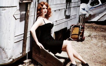 girl, red, model, feet, black dress, sitting, wavy hair, christina hendricks