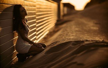 girl, sand, the fence, shadow, model, sitting, sunlight, closed eyes