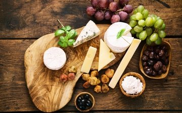 grapes, cheese, still life, olives, figs, dried fruits, dates, cutting board