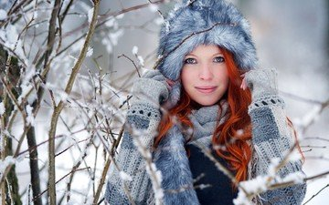 trees, snow, winter, girl, branches, look, model, face, hat, fur, sweater, redhead, wavy hair