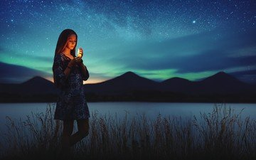 grass, night, lights, lake, mountains, girl, dress, stars, northern lights, silhouettes, candle, the milky way