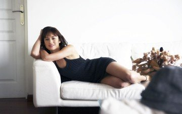 girl, dress, smile, brunette, actress, sofa, olga kurylenko, celebrity