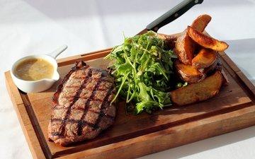 greens, leaves, board, meat, potatoes, steak