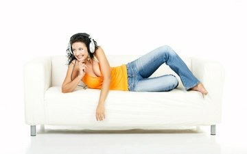 girl, smile, brunette, lies, headphones, jeans, white background, sofa, mike, barefoot