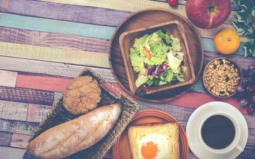 grapes, coffee, bread, apple, breakfast, mandarin, salad, scrambled eggs, toast