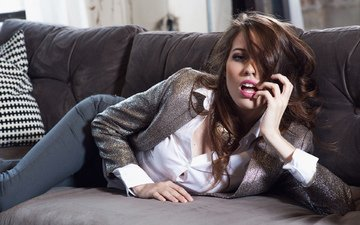 pose, brunette, look, lies, model, makeup, hairstyle, pillow, blouse, beautiful, on the couch, jacket, pants, sexy, caitlin mcswain