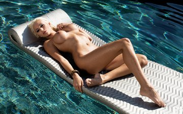blonde, naked, inflatable mattress