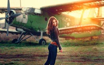 girl, the plane, pose, smile, model, jeans, legs, face, long hair, leather jacket, verronica