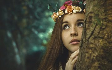 eyes, flowers, nature, tree, hand, girl, mood, background, portrait, look, face, trunk, sweetheart, wreath, freckles, brown hair, roses, long-haired