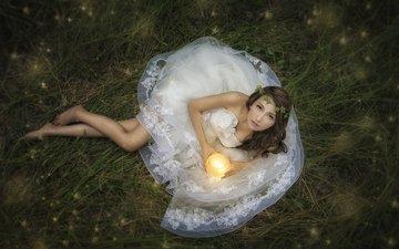 grass, girl, look, lies, model, legs, hair, face, hands, candle, the bride, photoshoot, flashlight