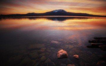 the sky, lake, mountains, nature, stones, shore, sunset, horizon, the bottom, snow peak