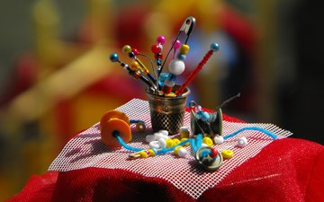 fabric, needles, thread, beads, pins, buttons, sewing