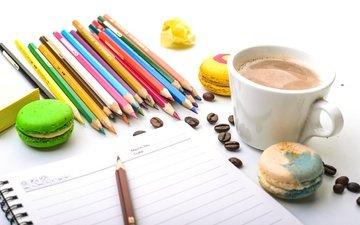 coffee, pencils, coffee beans, cookies, notepad, colored pencils, macaroon