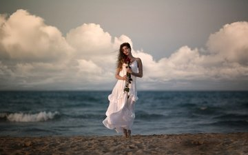 the sky, clouds, shore, girl, sea, dress, flower, model, the wind, ana valenciano
