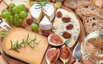 greens, nuts, grapes, food, cheese, bread, figs, a glass of wine