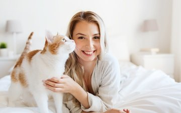 girl, blonde, smile, cat, bed, bathrobe