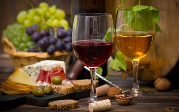 nuts, grapes, cheese, bread, wine, glasses