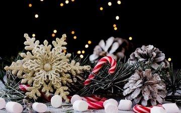 новый год, украшения, хвоя, фон, конфеты, блики, праздник, рождество, шишки, снежинка, декор