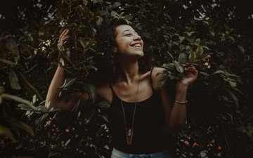 leaves, girl, smile, branches, look, model, hair, face, closed eyes, necklace.bracelet
