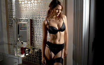 girl, pose, mirror, model, chest, stockings, curls, bedroom, cosmetics, bust, perfume, brown hair, neckline, black lingerie, wardrobe