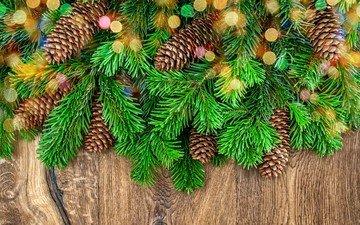 новый год, хвоя, ветки, блики, ель, рождество, шишки, деревянная поверхность