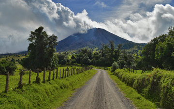 the sky, road, clouds, trees, nature, the fence, the volcano