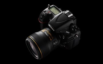 the camera, black background, camera, lens, nikon