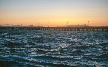 the sky, water, the evening, nature, wave, sunset, sea, bridge, pierce, the ocean