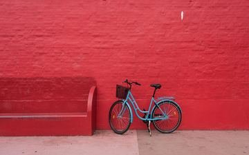 wall, bench, bike, red background