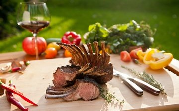 wine, vegetables, meat, tomatoes, pepper, rack of lamb