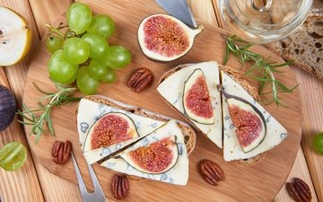 greens, nuts, grapes, sandwich, cheese, bread, figs