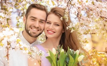 flowers, girl, smile, branches, joy, spring, tulips, male, lovers