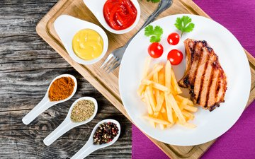 ketchup, meat, napkin, plate, spices, french fries, cutting board, grill, mustard, tomatoes-cherry