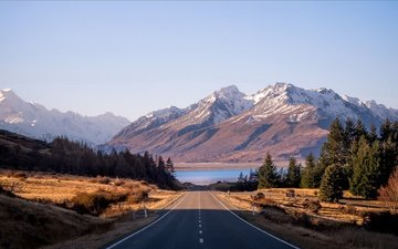 road, lake, mountains, the sun