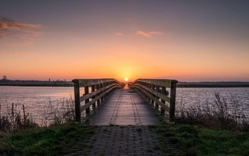 the sky, grass, clouds, river, the sun, shore, the bridge, sunset, horizon, dawn, summer, bridge, spring